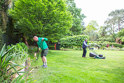 Two men doing gardening work together - p1026m1164187 by Patrick Frost