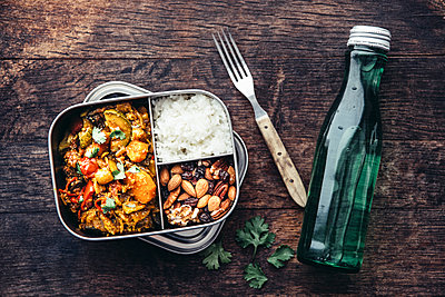 Take Away Food, tamarind vegetable stew, carrot, zucchini, bell pepper, eggplant, onion, tomato and falafel balls, rice and nuts with raisins - p300m2012618 by Ina Peters