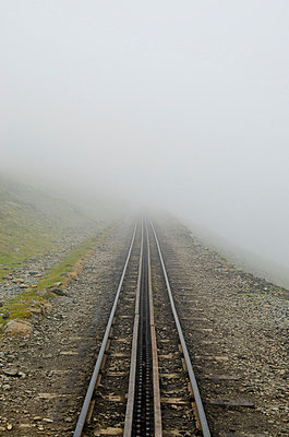Straight Railway Track Disappearing in Mist - p1072m993542 by chinch gryniewicz