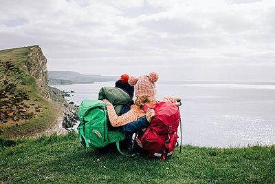 siblings hugging enjoying the beautiful Jurassic coast in Dorset - p1166m2279480 by Cavan Images