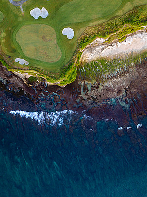 Indonesia, Bali, Aerial view of golf course with bunker and green at coast - p300m2023641 von Konstantin Trubavin