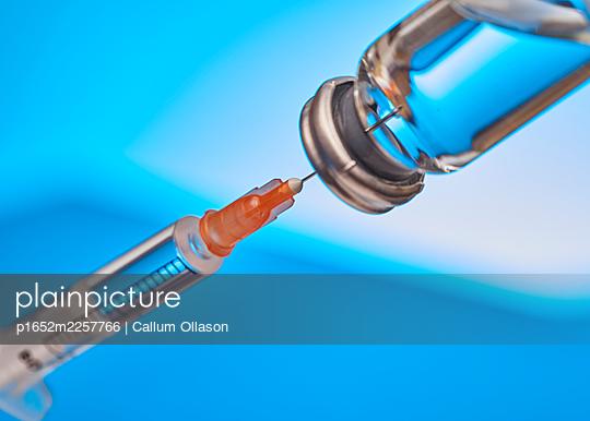 Syringe and vaccine, COVID-19 - p1652m2257766 by Callum Ollason