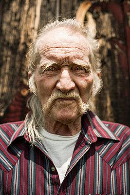 Senior man close up, portrait - p924m699189f by Bill Miles