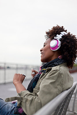 Woman listening to music - p6420226 by brophoto