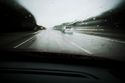 Vehicles travelling along a wet road  - p1057m1586855 by Stephen Shepherd