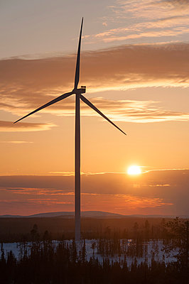 Wind turbine against sunset - p1079m1042383 by Ulrich Mertens