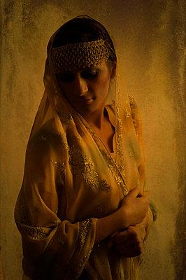 Sad Indian woman in sari - p7940255 by Mohamad Itani