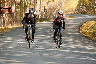 Man And Woman Riding Bikes - p4343063f by Susan & Neil Silverman