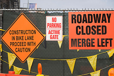 Construction signage on wire fence - p924m806916f by Ditto