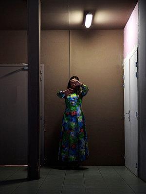 Woman in hallway - p1105m2082573 by Virginie Plauchut