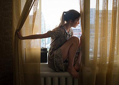 Girl Waiting in Window - p1503m2015972 by Deb Schwedhelm