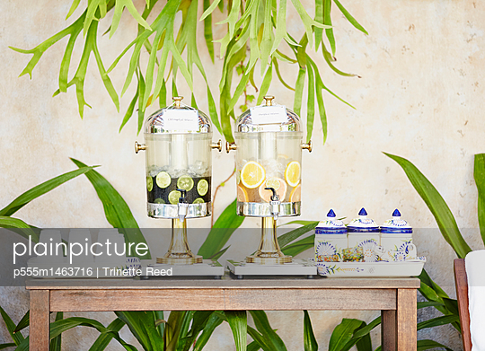 Fruit juice dispensers on table outdoors