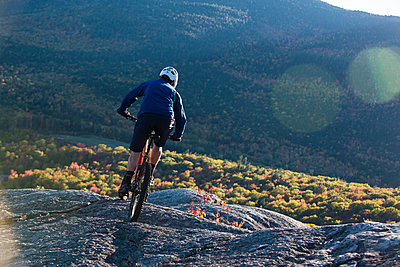 Mountain Biker On The Bare Granite Slabs Of Whitehorse Ledge In North Conway, New Hampshire - p343m1218244 by Joe Klementovich