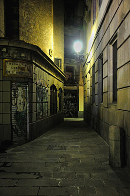 Deserted alleyway in Barcelona Spain - p1072m829278 by Neville Mountford-Hoare