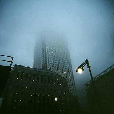 Canary Wharf Tower in mist - p1072m829289 by Neville Mountford-Hoare