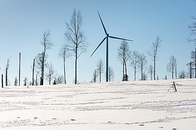 Wind turbine in snow scenery - p1079m1042378 by Ulrich Mertens