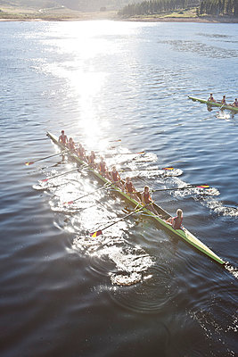 Elevated view of two rowing eights in water - p300m981458f by zerocreatives