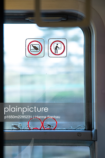 Train window with pictograms - p1650m2285231 by Hanna Sachau