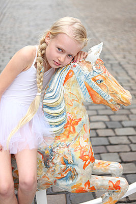 Girl with her rocking horse - p045m853535 by Jasmin Sander