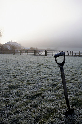 Spade in Dorset field with early morning frost - p349m789702 by Brent Darby