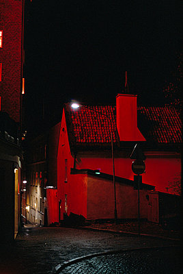 A street in red light Stockholm Sweden - p5281229f by Pia Isaksson