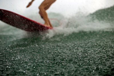 Surfing in the rain - p1108m1190926 by trubavin