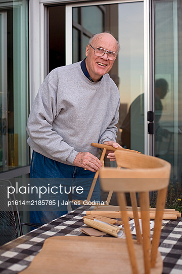 Retired man building a chair - p1614m2185785 by James Godman