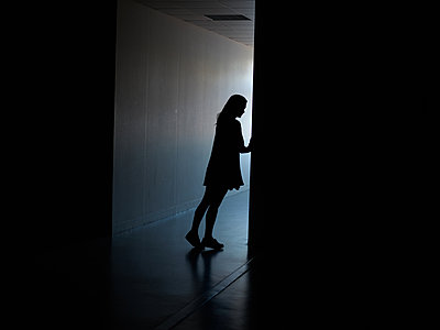 Woman in a dark hallway - p1413m2278734 by Pupa Neumann