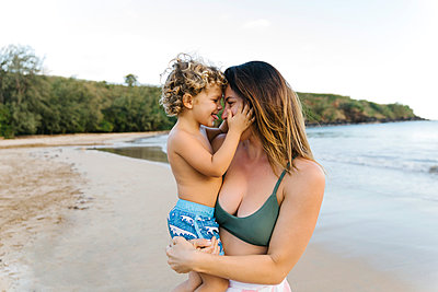 Woman with her son on beach - p1427m2109795 by Jessica Peterson