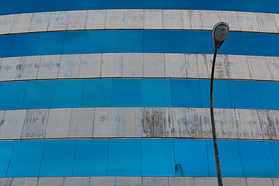 Street lamp in front of facade - p300m1120444f by visual2020vision