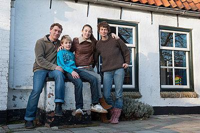 Homeowners looking proud - p896m835049 by Sabine Joosten