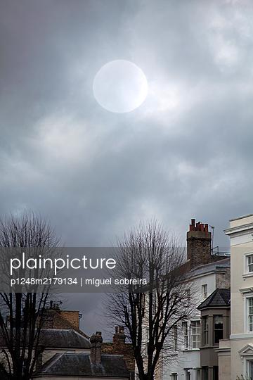 Buildings Against Grey Moonlit Sky  - p1248m2179134 by miguel sobreira