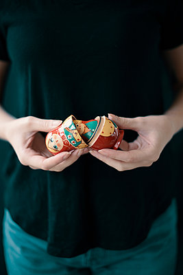 Woman's Hands Holding Open Russian Doll - p1617m2264085 by Barb McKinney
