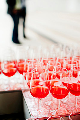 Large group of red wine glasses arranged on table - p426m747307f by Astrakan
