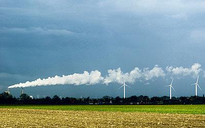 Wind turbines and factory smoke - p42918739 by Mischa Keijser