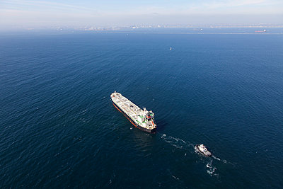 Oil tanker with tugboat at sea - p555m1420393 by Tom Paiva Photography