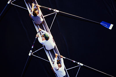 Overhead view of men rowing scull boat during competition in Seattle. - p1100m1220578 by Mint Images