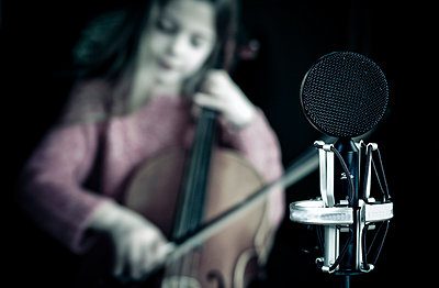 Girl playing cello - p896m835081 by Richard Brocken