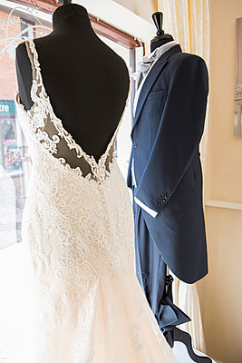 Wedding dress and tuxedo placed in window of bridal shop - p1026m1164213 by Patrick Frost