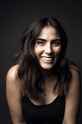 Portrait confident beautiful young Latina woman laughing - p1192m2066171 by Hero Images