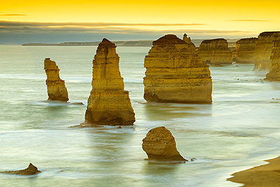 The Twelve Apostles at Sunset, Great Ocean Road, Australia - p651m2006320 by Tom Mackie