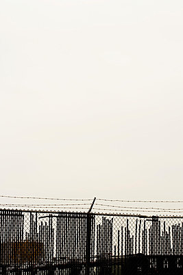 Barbed wire fence and skyline - p9240743 by kohrling