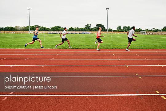 Runners training on running track - p429m2068941 by Matt Lincoln