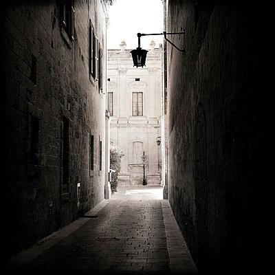 Narrow cobbled stone street - p1072m829105 by Kevin Mallia