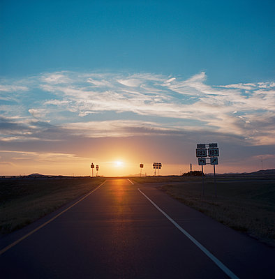 Sunset on american road - p1610m2181490 by myriam tirler