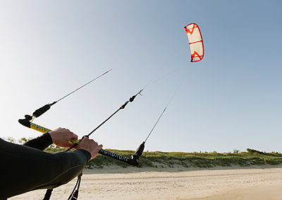 Arms of kiteboarder holding the kite - p300m2118648 by Hernandez and Sorokina