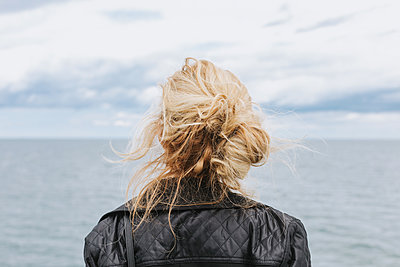 Young woman looking out to sea, rear view, Menemsha, Martha's Vineyard, Massachusetts, USA - p924m2058122 by Lena Mirisola