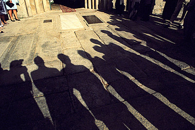 Persons standing around a tomb slab, Santiago de Compostela, Galicia, Spain - p4901688 by Jan Mammey