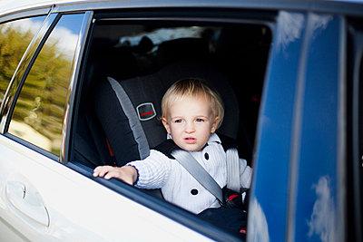 Boy in car - p924m744512f by Alys Tomlinson