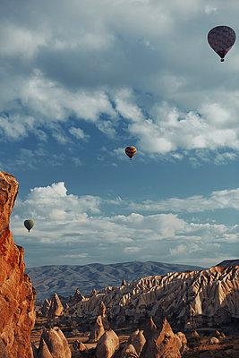 Air balloons flying over the rocks of Cappadocia - p1577m2175344 by zhenikeyev